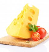 Piece of cheese and tomatoes, on wooden board, isolated on white
