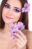 Beautiful young woman with flowers close up