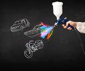 image of air paint gun  - Man with airbrush spray paint with car - JPG