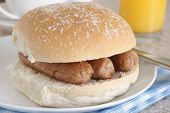 stock photo of baps  - Sausage sandwich or sausage bap a favourite British snack - JPG