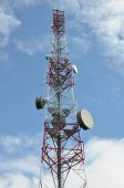 Telecommunication tower with phone antenna systems