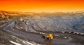 stock photo of iron ore  - Dump trucks and roads to deliver ore and auxiliary cargo career on extraction of iron ore - JPG