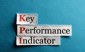 picture of indications  - key performance indicator KPI on blue paper - JPG