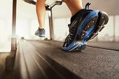 stock photo of treadmill  - Man running in a gym on a treadmill concept for exercising - JPG