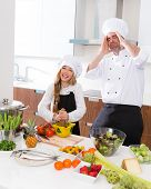 Chef master and junior kid girl at cooking school crazy man about pupil recipe