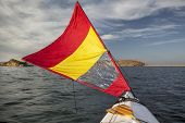 pic of horsetooth reservoir  - canoe bow with a downwind sail  on Horsetooth Reservoir in Colorado near Fort Collins - JPG