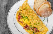 stock photo of chive  - Omelet with bacon and cheese home bread and chive on top - JPG