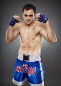 foto of muay thai  - Kickbox or muay thai fighter in guard stance - JPG