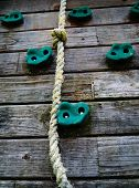 stock photo of overcoming obstacles  - A rope on a climbing wall representing hard work and overcoming obstacles to achieve success.