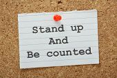 picture of united we stand  - The phrase Stand Up and Be Counted typed on a piece of land paper and pinned to a cork notice board as a reminder - JPG