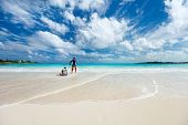 image of boogie board  - Beautiful tropical beach at Exuma Bahamas with father and son having fun - JPG