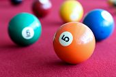 picture of pool ball  - billiard balls in a pool red table - JPG