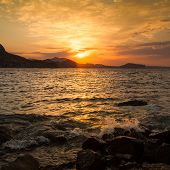 picture of sea-scape  - Golden sunrise over the sea against the background of the cloudy sky - JPG