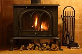 stock photo of cozy hearth  - Fire burning in the cozy fireplace close up - JPG