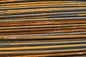 stock photo of reinforcing  - Stack of the metal rusty reinforcement bars - JPG