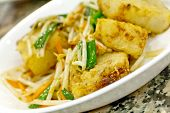 stock photo of turnips  - Chinese pan fried turnip cakes Law Bock Gow with bean sprouts and scallion - JPG