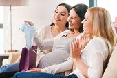 picture of young baby  - Happy young pregnant woman receiving gifts from her friends on baby shower party - JPG