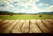 foto of wooden table  - Wooden empty table. Wooden display with spring fields bokeh.