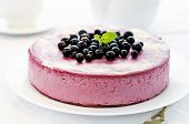 stock photo of cheesecake  - black currant cheesecake on a white plate  - JPG