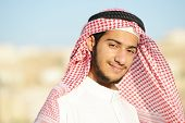 stock photo of middle eastern culture  - Positive Middle eastern young guy - JPG