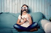 pic of mustache  - Image of funny little girl making faces with mustache props - JPG