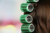 picture of hair curlers  - Long female hair during hair dressing with curler - JPG