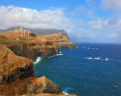 foto of atlantic ocean  -  Over a cliff on the ocean breeze are the windmills - JPG