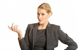 stock photo of confusing  - Confused woman showing irritate gesture - JPG