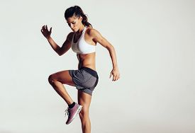 foto of studio  - Attractive fit woman exercising in studio with copyspace - JPG