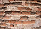 picture of fragmentation  - Fragment of the old wall of the destroyed bricks with wide angle distortion view closeup - JPG