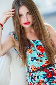 foto of freckle face  - Young beautiful woman brunette with long hair and green eyes - JPG