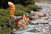 picture of cap gun  - Cat the hunter with the gun on a track - JPG