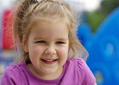 picture of little young child children girl toddler  - Portrait a little girl on playground - JPG