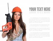 foto of hammer drill  - Young sexy female dressed in jeans and orange helmet holding hammer  electric drill - JPG