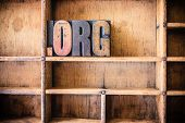 foto of word charity  - The word DOT ORG written in vintage wooden letterpress type in a wooden type drawer - JPG