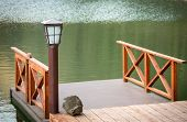 image of jetties  - Wooden jetty with lamp near water surface - JPG
