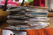foto of flea  - Old vinyl records pile on flea market - JPG