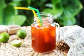 image of iced-tea  - Ice tea with fresh lime by lemon reamer - JPG