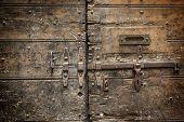 stock photo of door-handle  - Metal rusty door handle on wood background - JPG