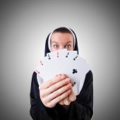 picture of nun  - Nun in the gambling concept - JPG