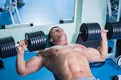stock photo of dumbbells  - Strength training with dumbbells - JPG