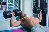 foto of dumbbells  - Strength training with dumbbells - JPG