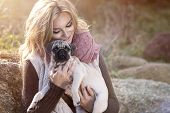 picture of pug  - Young girl smiling in autumn scenery with pug dog - JPG