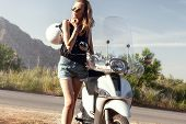 image of scooter  - Beautiful young blonde girl traveling - JPG