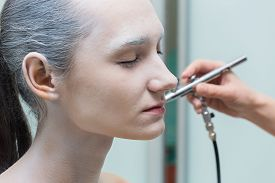 pic of airbrush  - The process of putting airbrush make up - JPG