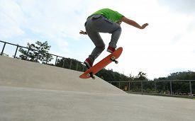 foto of skateboard  - closeup of young woman skateboarder skateboarding at skatepark - JPG