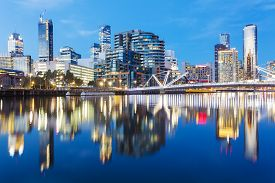 picture of reflections  - Cityspace of Dockland in Melbourne at sunset with reflection - JPG