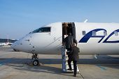 foto of hydrofoil  - businesspeople are boarding into the airplane on the runway - JPG