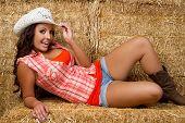 pic of hay bale  - Beautiful smiling cowgirl in hay - JPG