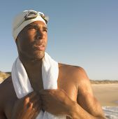 image of close-up  - Man in swimming cap with towel around neck - JPG